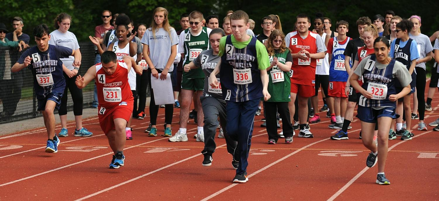 Students from different high schools take part in a unified track and field race at Milford High School